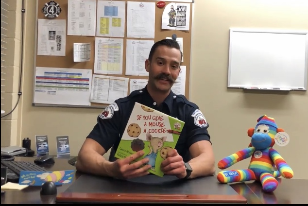 A Napa Fire Fighter reading a book at a desk.