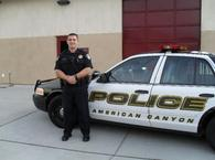 American Canyon Police Department Officer Next to Car