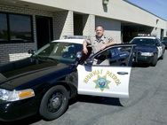 California Highway Patrol Officer Next to Car